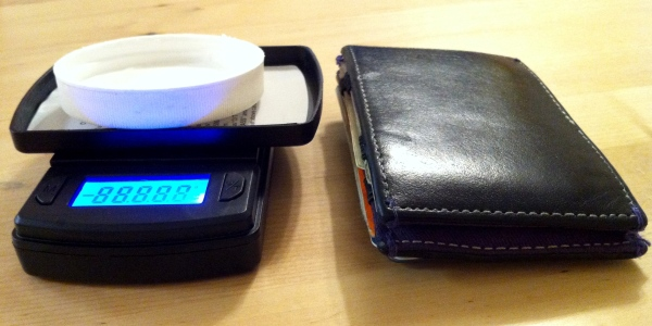 Small digital scale for measuring cream T. Wallet for size comparison.